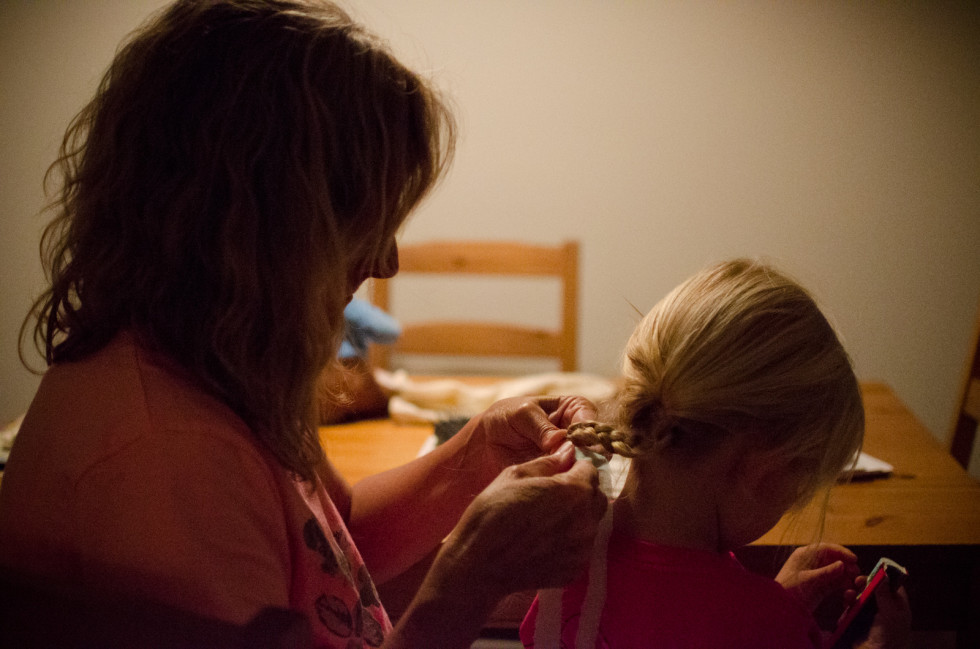Mom braiding Charlotte's hair (June 2014)